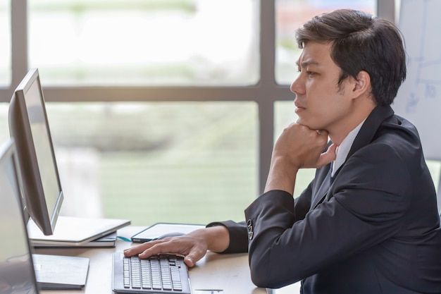 Young businessmen are stressed at the office desk Premium Photo
