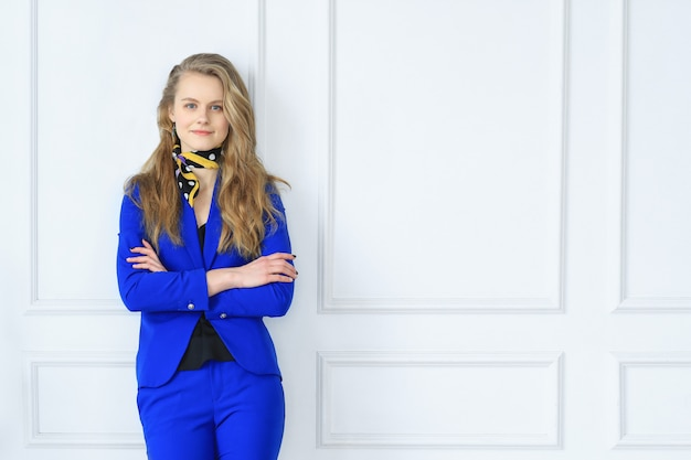 Young businesswoman in blue dress Free Photo