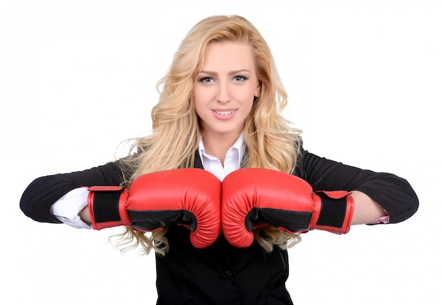 Young businesswoman in boxing concept. Premium Photo