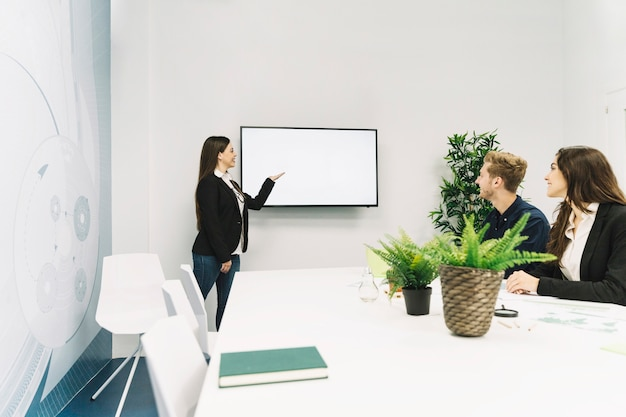 Young businesswoman giving presentation in office Free Photo