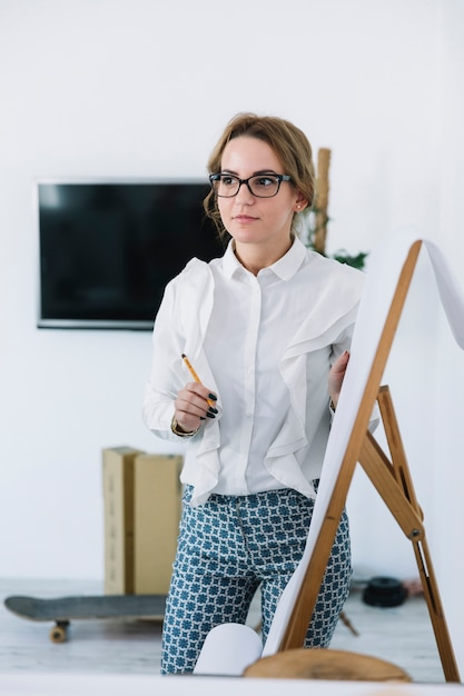Young businesswoman holding pencil explaining new business plan Free Photo
