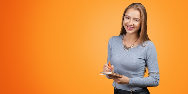 Young businesswoman taking notes Premium Photo