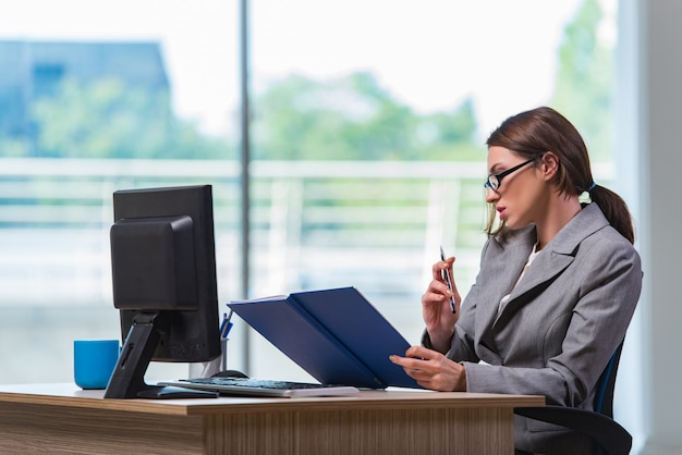 Young businesswoman tired after long working day Premium Photo