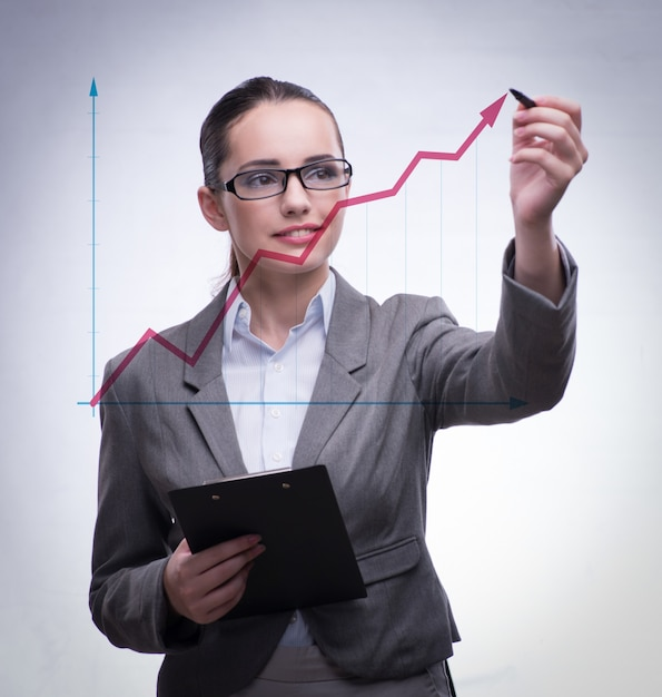 Young businesswoman with chart diagrams Premium Photo