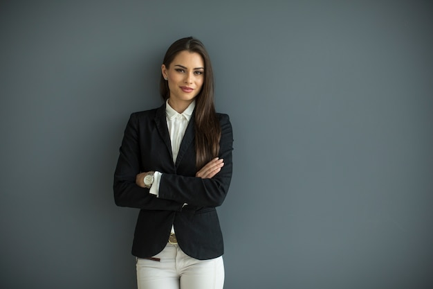 Young bussiness woman by the wall Premium Photo