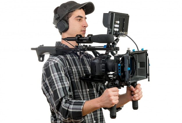 Young cameraman with movie camera Premium Photo