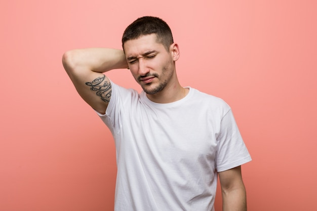 Young casual man suffering neck pain due to sedentary lifestyle. Premium Photo
