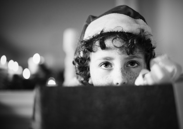Young caucasian boy with christmas present box Free Photo