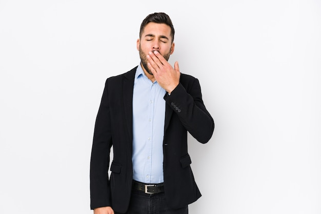 Young caucasian business man against a white background isolated yawning showing a tired gesture covering mouth with hand. Premium Photo