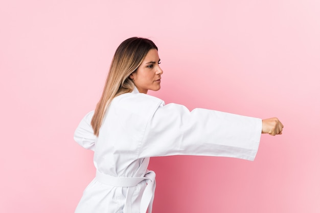 Young caucasian karate woman isolated Premium Photo