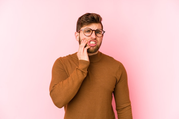 Young caucasian man having a strong teeth pain, molar ache. Premium Photo