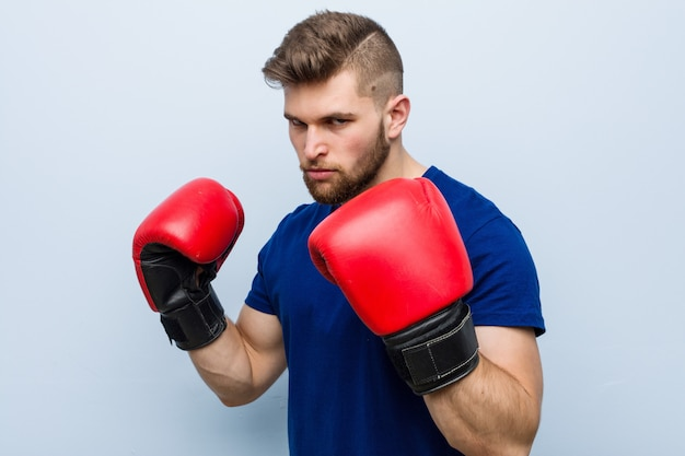 Young caucasian man wearing a boxing gloves Premium Photo