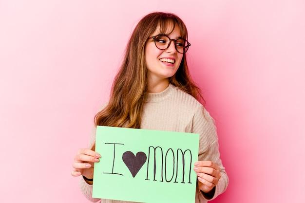私はママのプラカードが大好きな若い白人女性 Premium写真