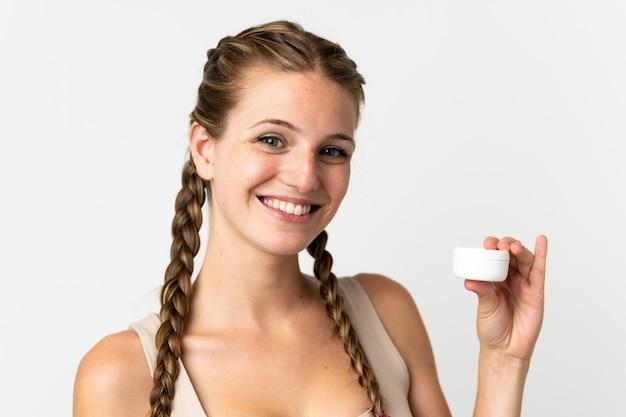 로션 화이트에 고립 된 젊은 백인 여자 프리미엄 사진