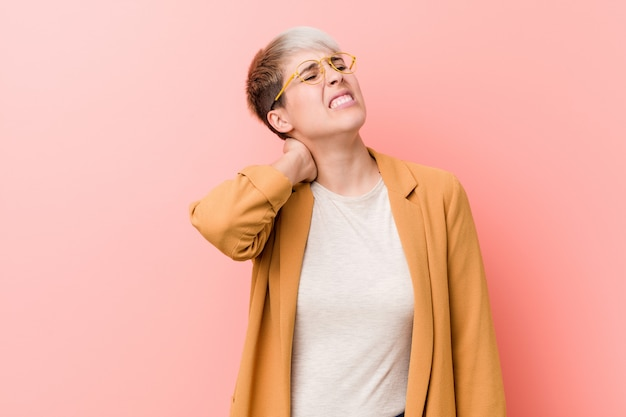 Young caucasian woman wearing a casual business clothes suffering neck pain due to sedentary lifestyle. Premium Photo