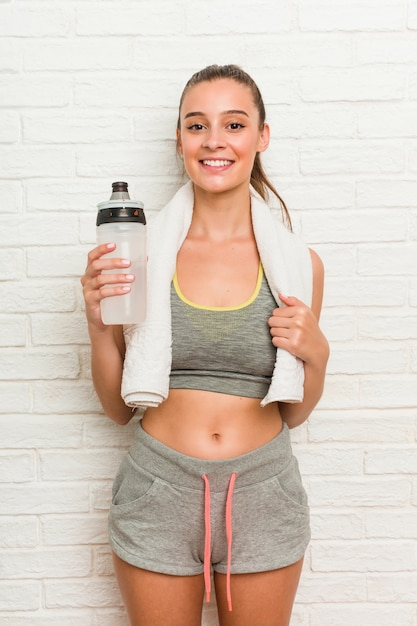 Young caucasian woman wearing sport clothes with a water bottle Premium Photo