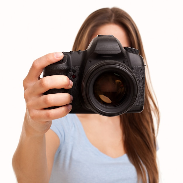 Young caucasian woman with camera Free Photo