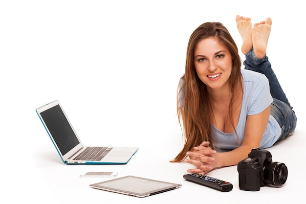 Young caucasian woman with electronic devices Free Photo