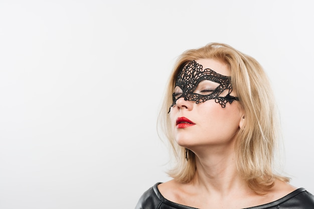 Young charming blond lady in mask Free Photo