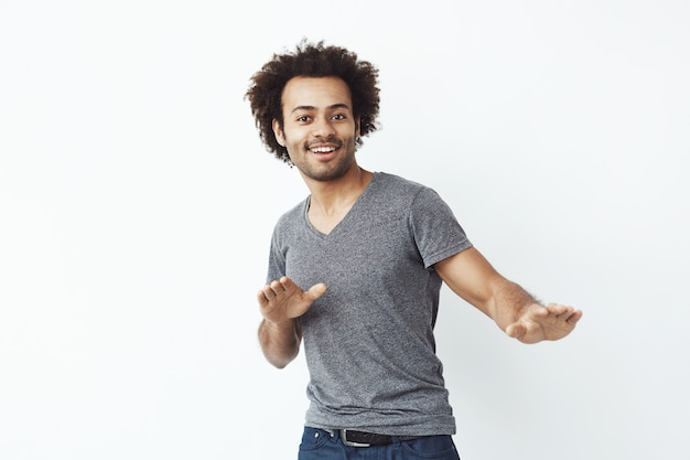 Young cheerful african man moving dancing. Free Photo