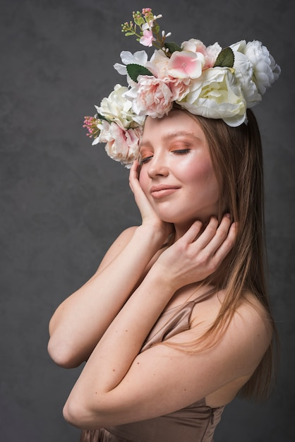 Young cheerful sensual woman in dress with beautiful flower wreath Free Photo