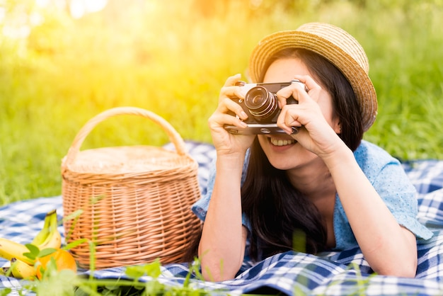 Young cheerful woman taking photo in nature Free Photo