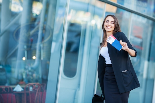 Young cheerful woman with a suitcase Premium Photo