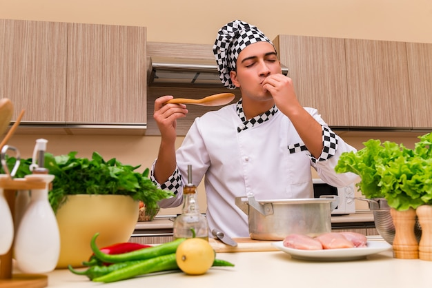Young chef working in the kitchen Premium Photo