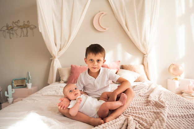 Young Child Holding Newborn Baby Photo Free Download