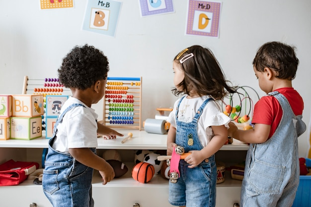 Young children playing with educational toys Premium Photo