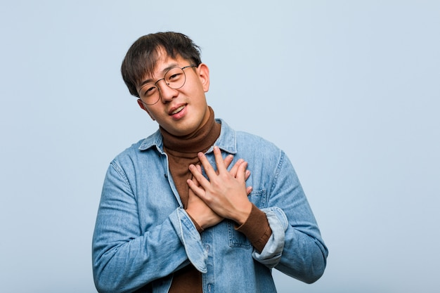 Young chinese man doing a romantic gesture Premium Photo
