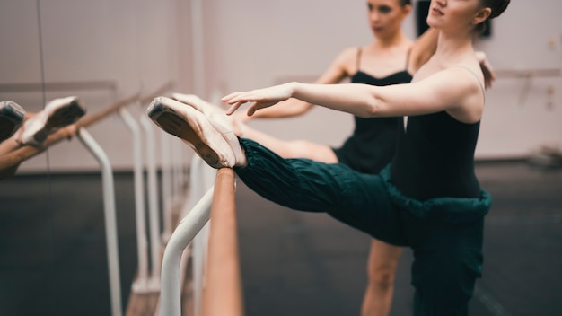 Young classic female dancers practising in the dance studio Free Photo