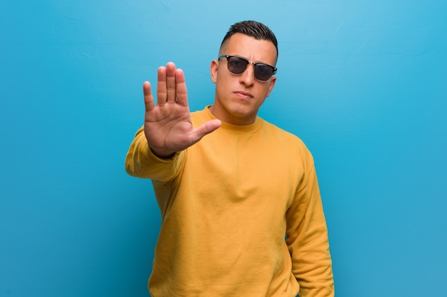 Young colombian man putting hand in front Premium Photo