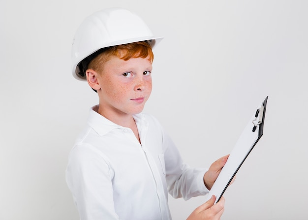 Young construction kid with helmet Free Photo