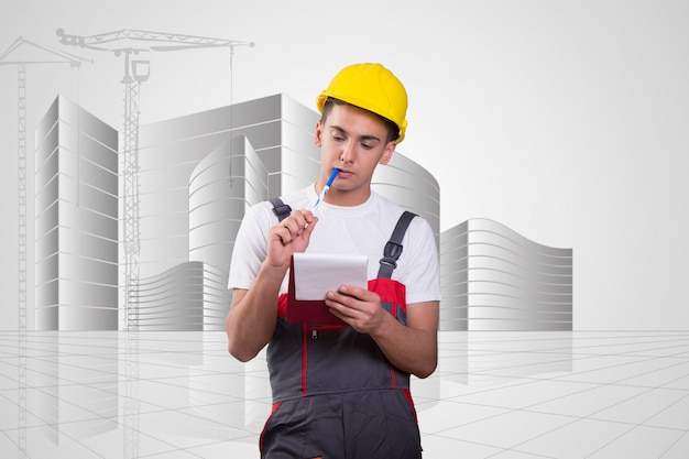 Young construction worker taking notes Premium Photo