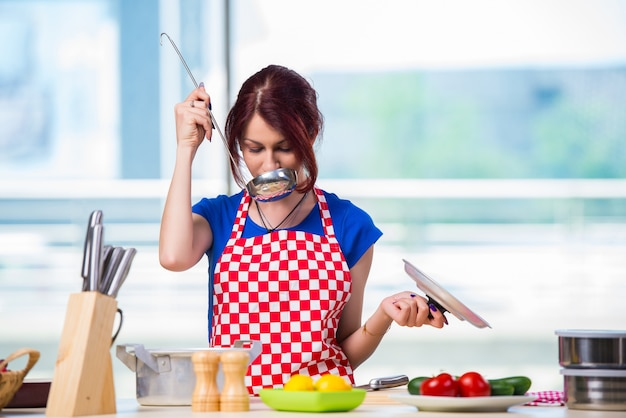 Young cook working in the kitchen Premium Photo