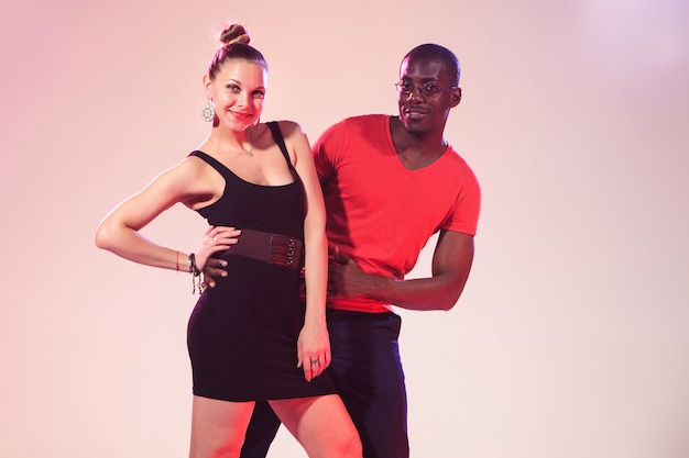 The young cool black man and white woman is dancing Free Photo