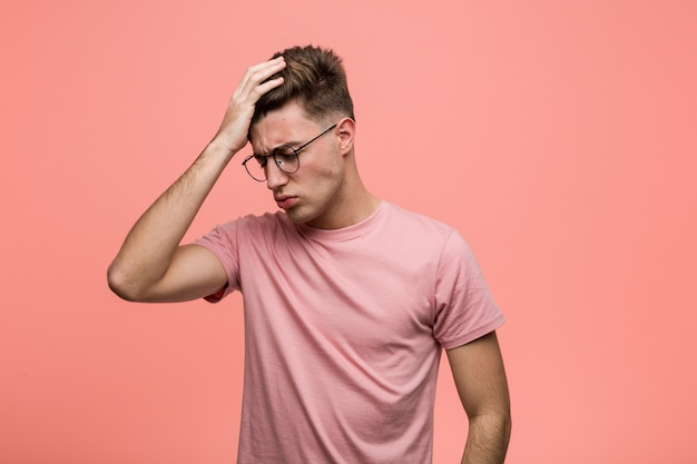 Young cool caucasian man forgetting something, slapping forehead with palm and closing eyes. Premium Photo