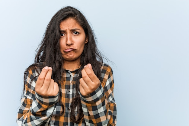 Young cool indian woman showing that he has no money Premium Photo