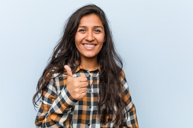 Young cool indian woman smiling and raising thumb up Premium Photo