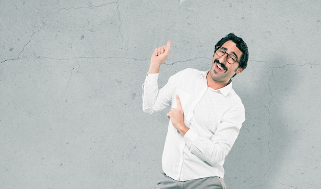 Young cool man against cement wall Premium Photo