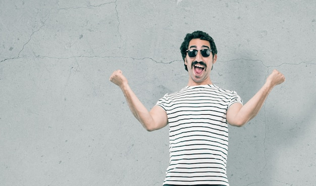 Young cool man against grunge background Premium Photo