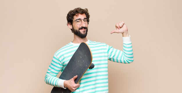 Young cool man bearded with a skate board Premium Photo