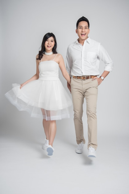 Premium Photo Young Couple Asian Groom And Bride In Casual Wedding Dress Walking And Having Fun,African American Black Woman Wedding Dress