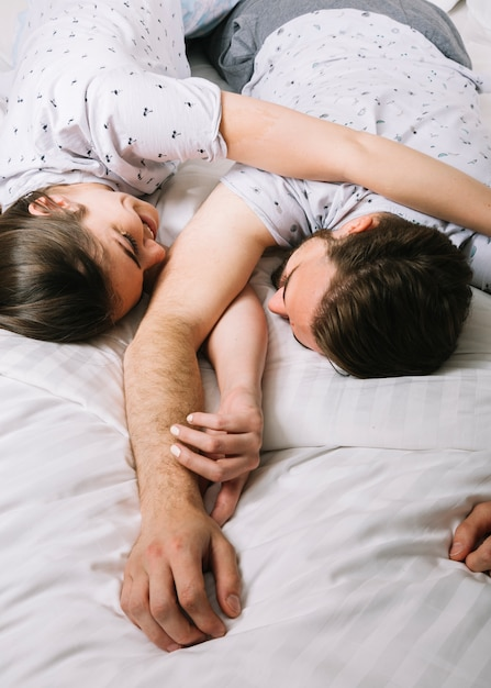 Young couple in bed in the morning Free Photo
