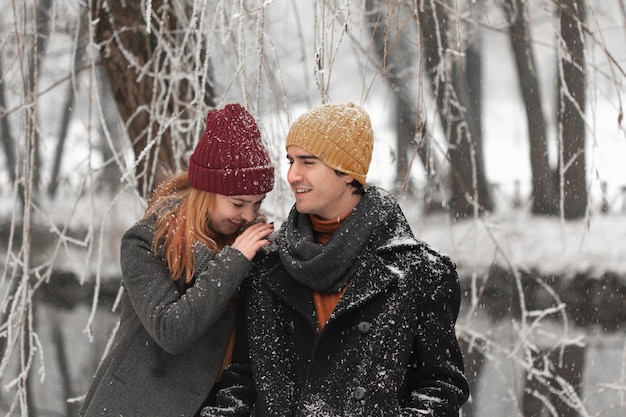 Young couple being happy in the cold days of winter Free Photo