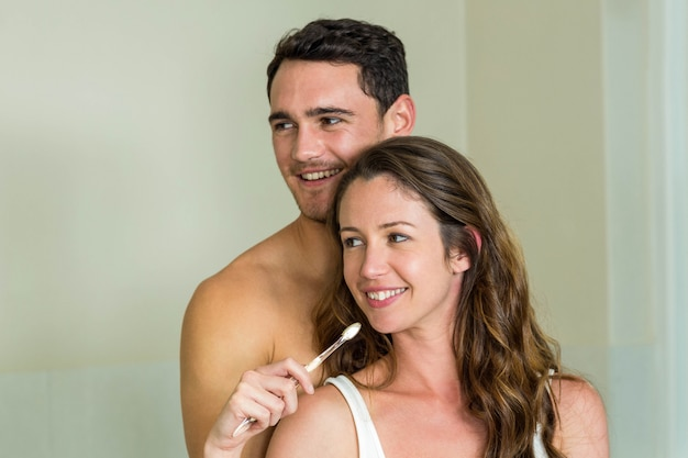 Young couple brushing their teeth at home in the bathroom Premium Photo