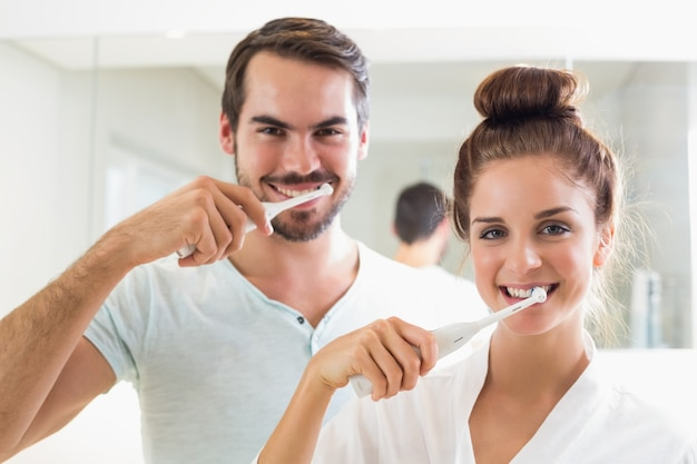 Young couple brushing their teeth Premium Photo