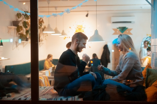 Young couple in cafe with stylish interior Free Photo