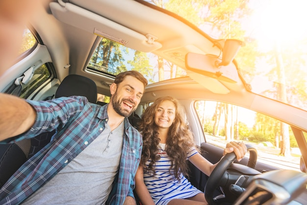 Young couple on a car trip Free Photo